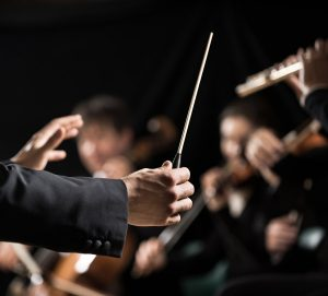 bigstock-Orchestra-Conductor-On-Stage